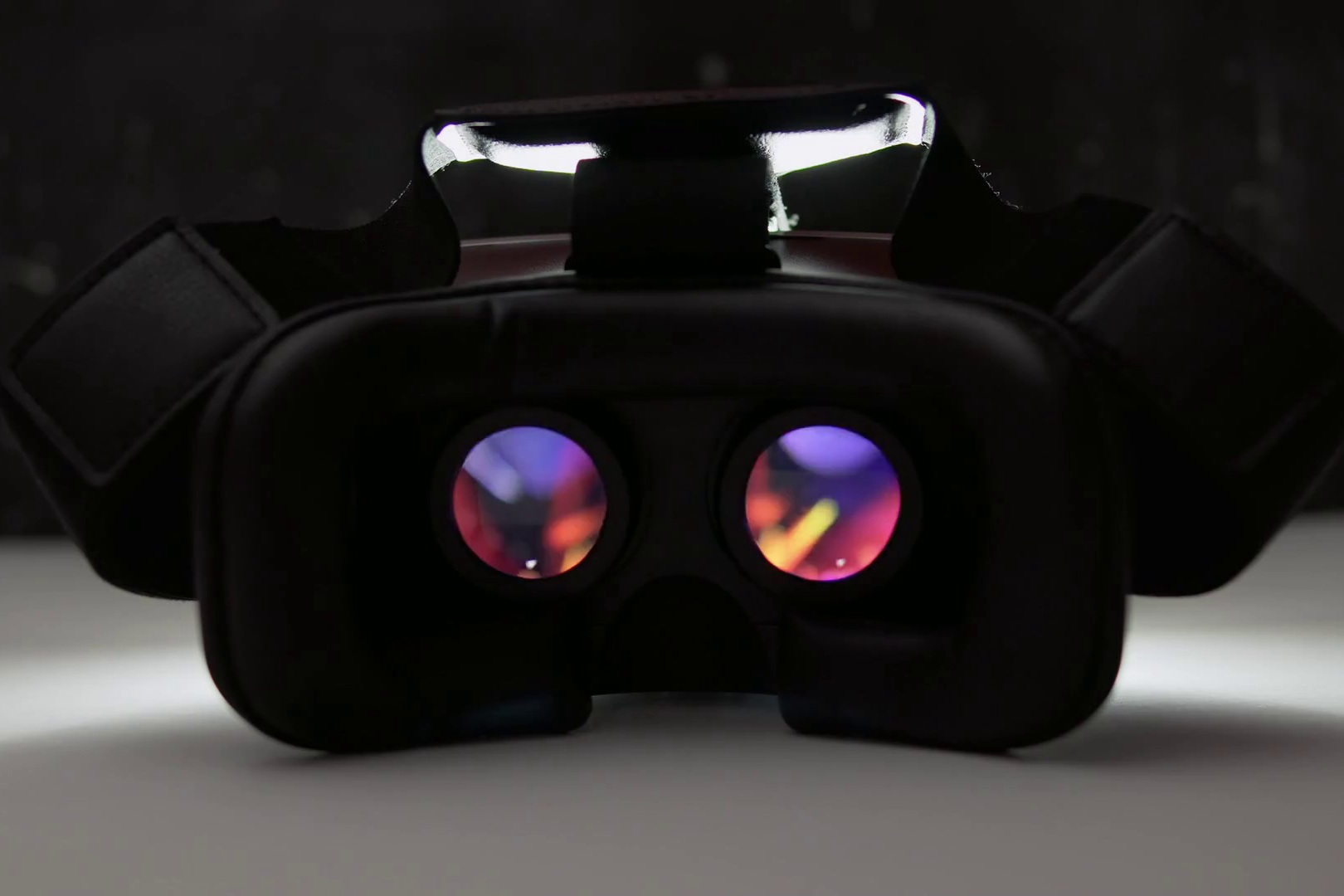 videoblocks-movie-playing-inside-virtual-reality-device-at-night-indoor-on-white-table-and-dark-background-black-vr-goggles-modern-technologies-concept-4k-uhd-video_h6wzp6eyz_thumbnail-full01.jpg