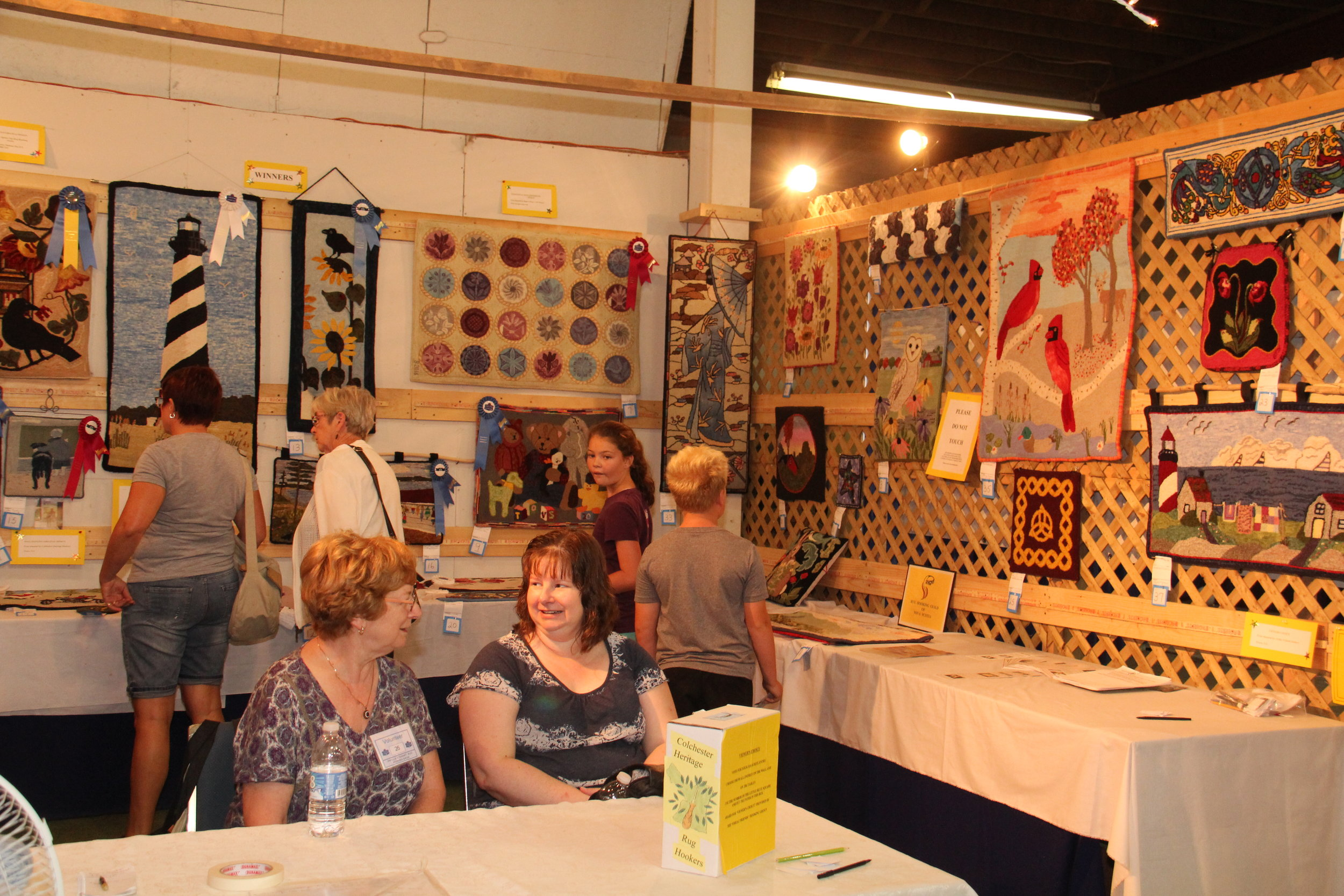 Friendly and helpful Volunteers oversee the displays at the Exhibition and answer visitors questions.