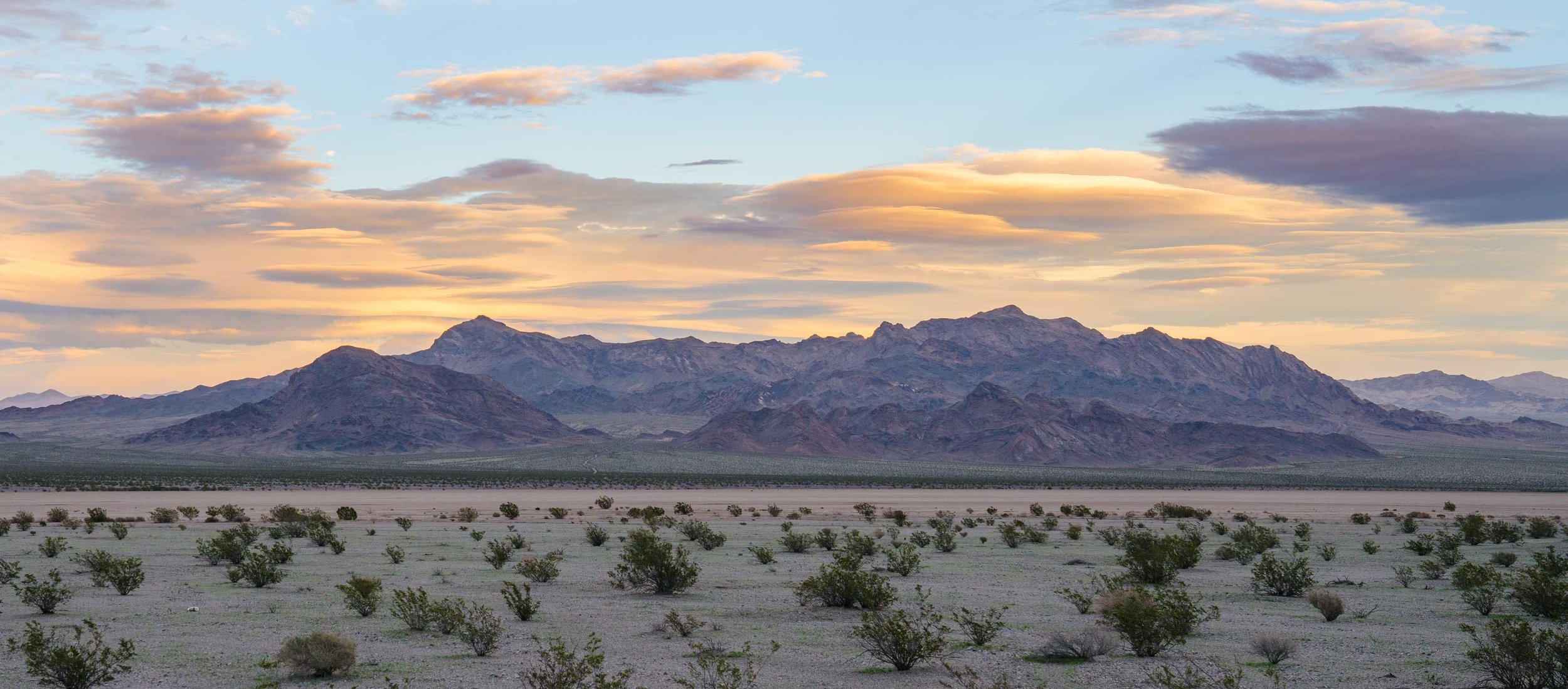 A sunset with lenticular cloud formations near Tecopa.