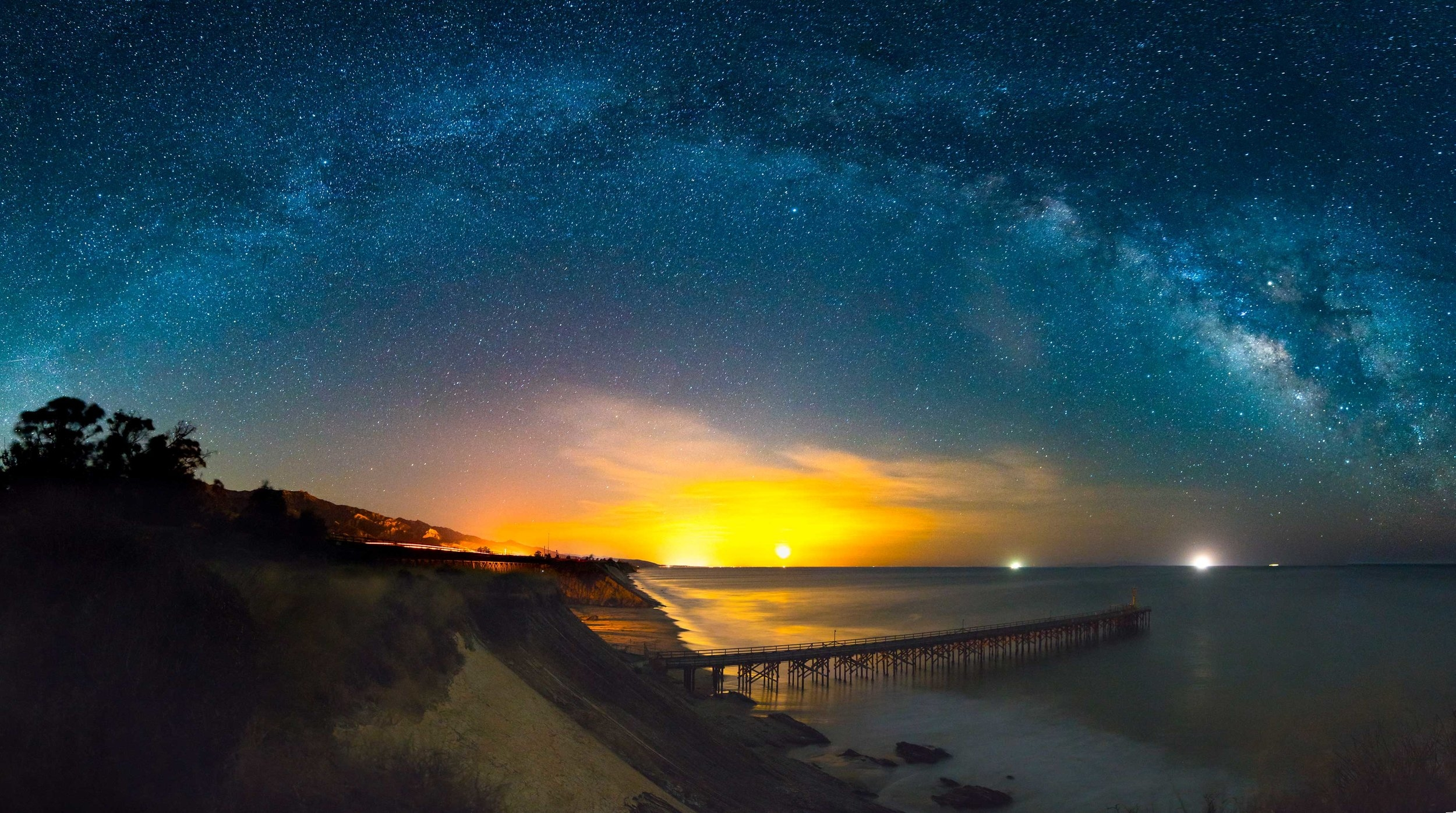 Panorama of the Milky Way, With Moonrise At Center. Gaviota Beach, CA. 6 portrait oriented shots, F2.8, 30 sec., ISO 3200. Edited in Adobe Lightroom and Photoshop.