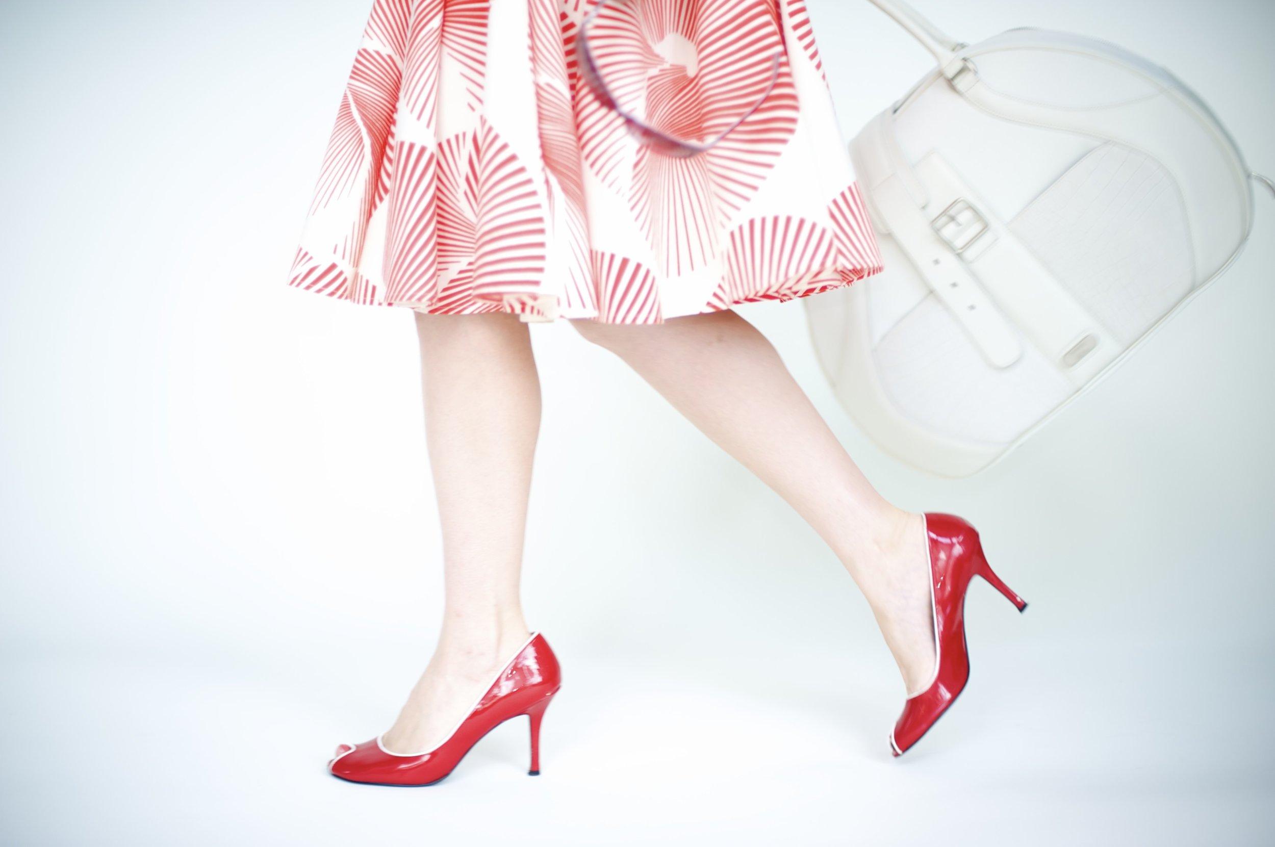 red heels white bag walking.jpg