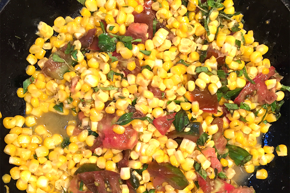 Ingredients:   3 ears of Corn  1 medium tomato  ½ cup finely chopped Basil  2 Tbsp sweet Butter  ½ medium red onion, chopped  1 tsp.     Chef Josef's Original Seasoning blend    ¼ cup water    With a sharp knife, remove the kernels from the cob:     (see video)    Set aside.    Sauté the onion in butter until translucent.  Add Corn, tomato, basil and     Chef Josef's Original Seasoning blend    Add ¼ cup water and bring it to a quick steam.  (To keep the corn from getting tough and starchy, bring it to a quick steam, turn off the burner and let it sit with a lid on it.)    This recipe makes a great salad for the next day. Just add a little vinegar and oil.