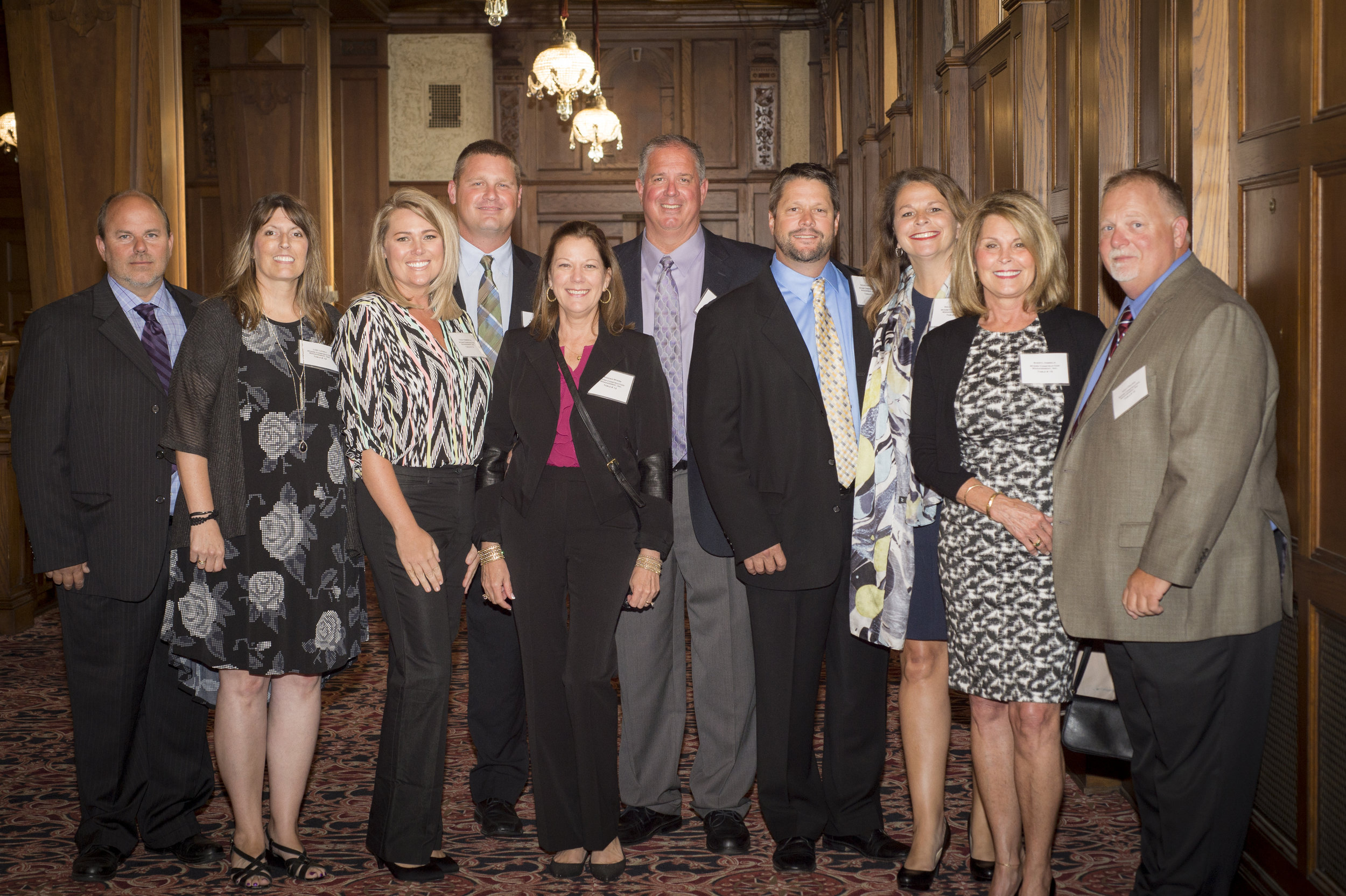 MCMI team members and their guests present to accept awards. Left to right: Jason Lovell, Lori Lovell, Tracy Emberton, Robert Emberton, Sandra Myers, Don Myers, Steve Ferguson, Sally Ferguson, Sheryl Hibbeln and Kent Fielden.