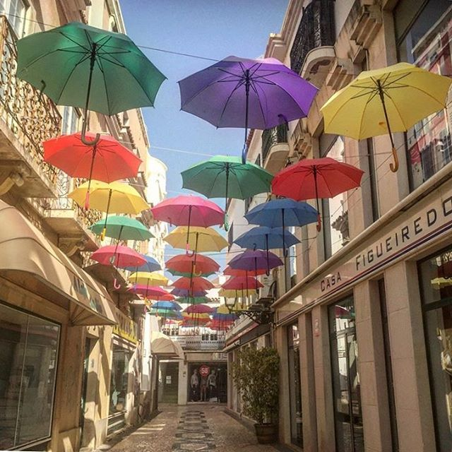 A beautiful street in Olhao, Portugal. Colourful umbrellas giving much needed shade on our Summer sojourn! #stayhydrated #drinkwater #bottledwater #umbrella #portugal