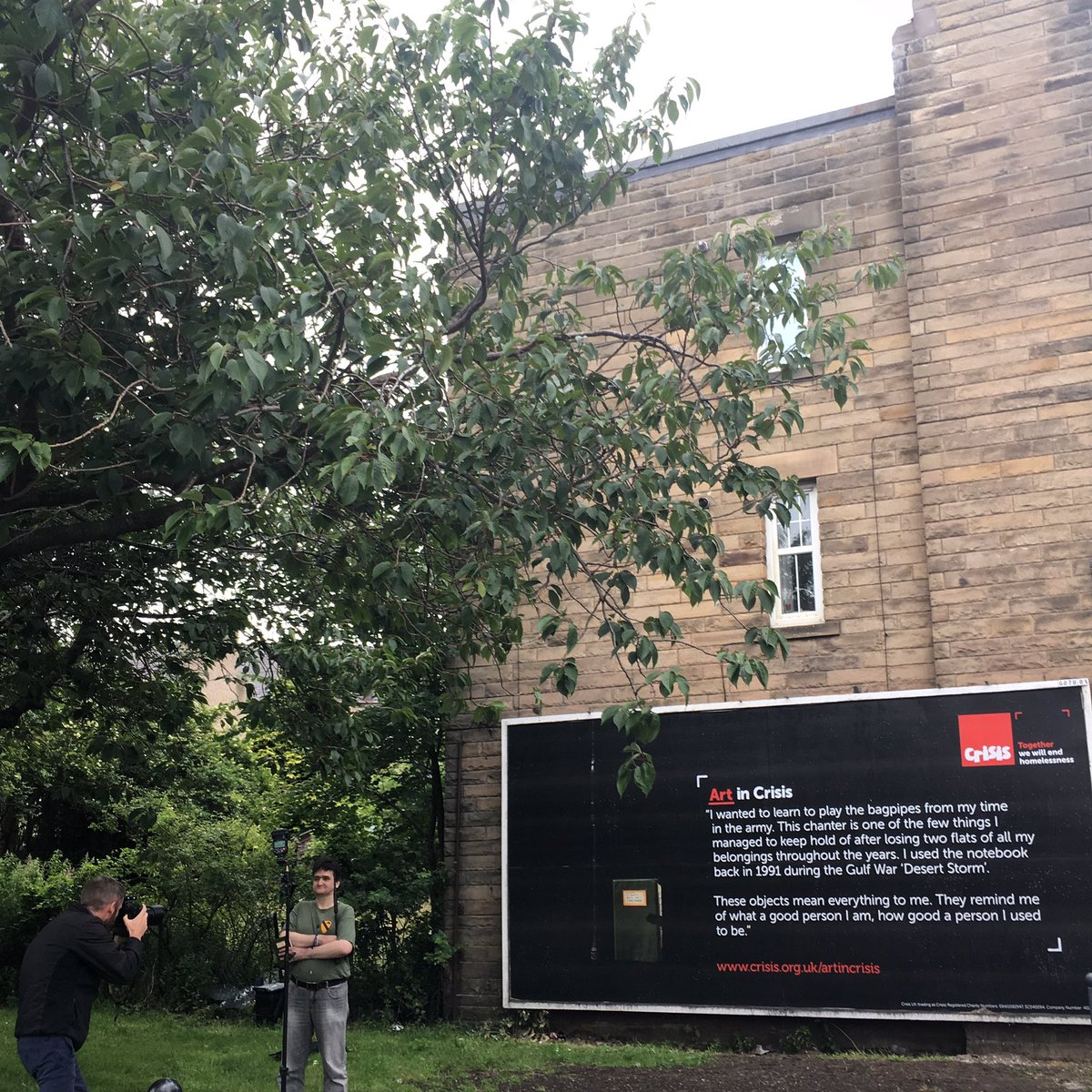 Ex-serviceman Jamie Robertson being photographed for The Scotsman with his billboard. 5th July 2017