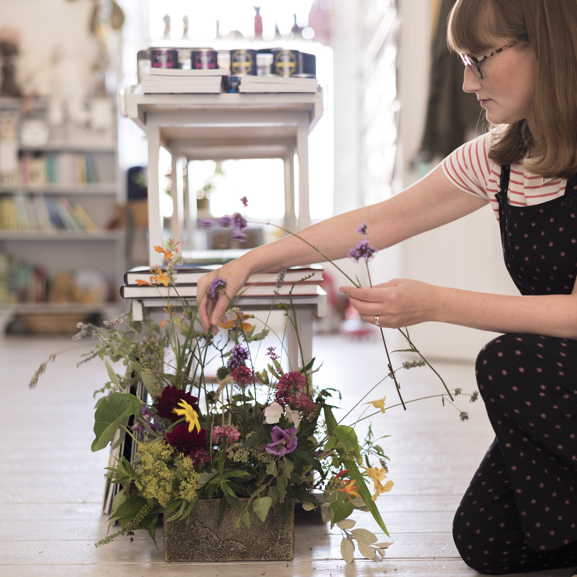 Jen Bell Harman arranging locally sourced flowers inside Cove