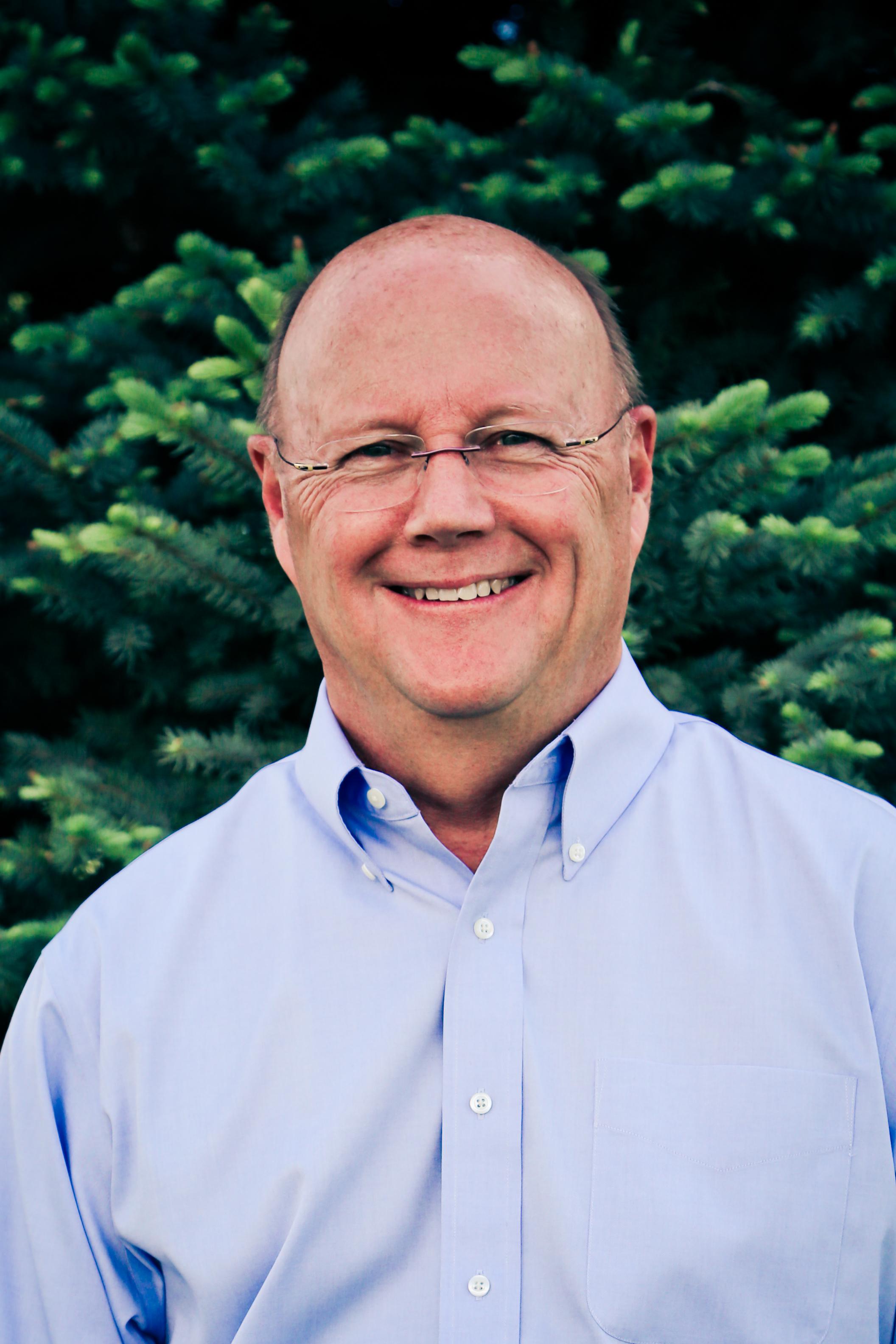 Dr. Larry E. Brazil, Chairman