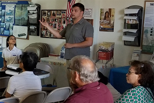 Cody Rewis, Observer Coordinator with the NOAA Southeast Fisheries Science Center, presents alternative gear catch data to vessel owners and the project team at the Coastal Communities Consulting office in Gretna, Louisiana.