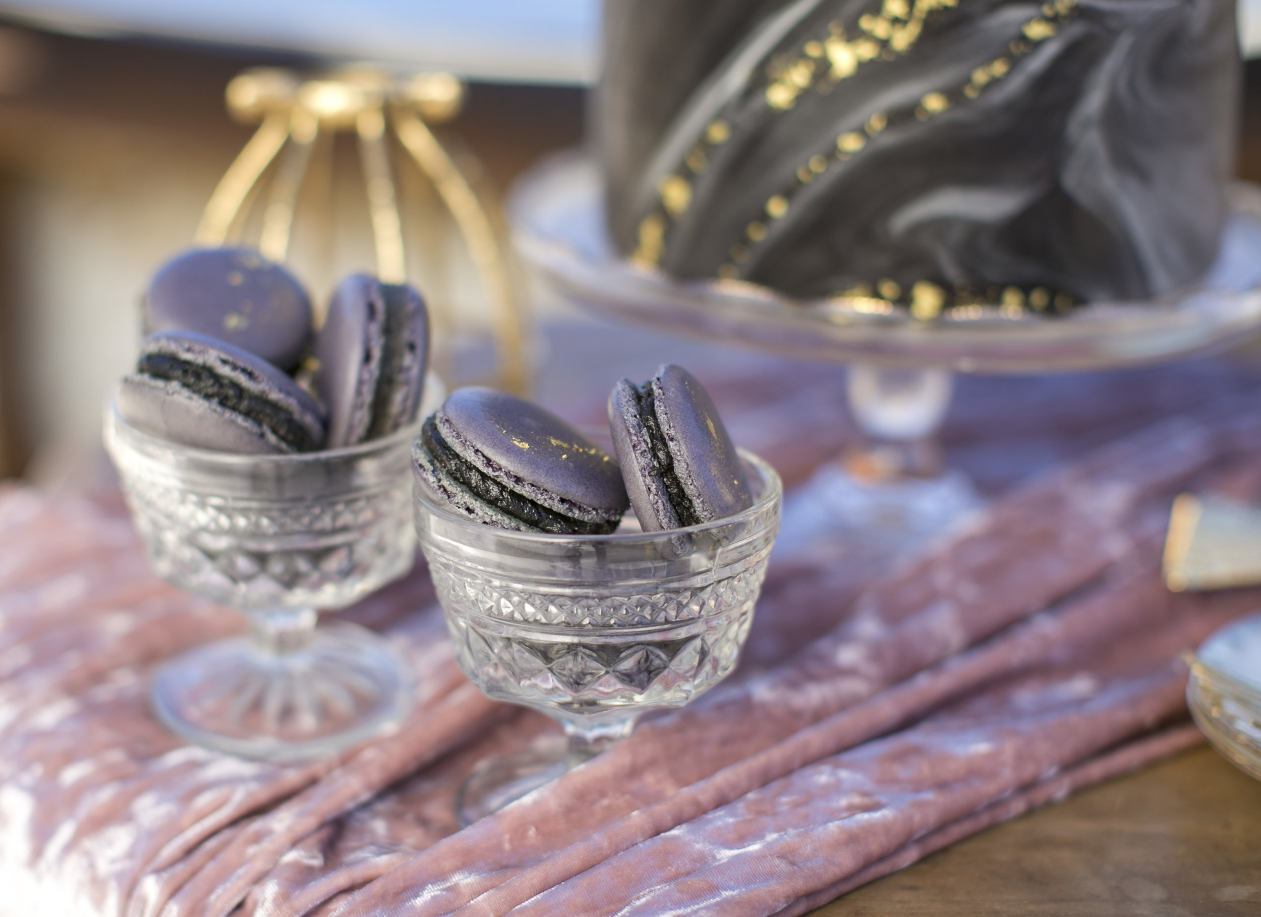 Dark chocolate macaroons with gold flecks