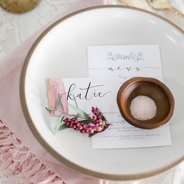 "Layers, details, and a touch of color. These are the little things that tell your guests, ""You mean the world to me. Thanks for having a place at our table."" . . . . Photo: @cadeyreisnerweddings  Paper: @emily_costopoulos  Floral: @victoriasgardenafloralco  Design & Styling: @thevintagelease  Venue: @thelocalsturgis"