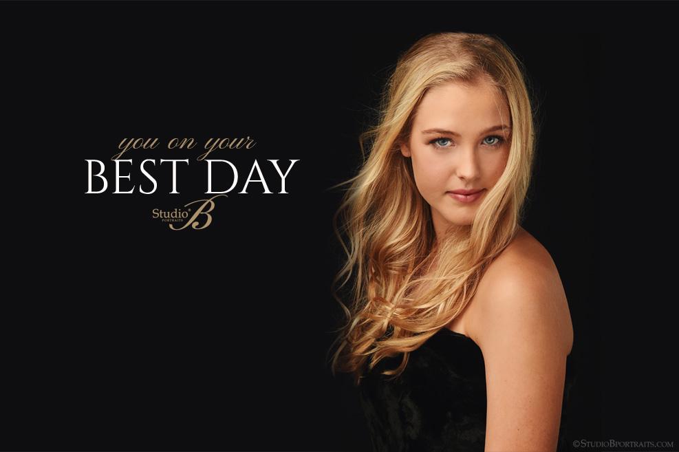 pretty blonde woman in black dress against black backdrop