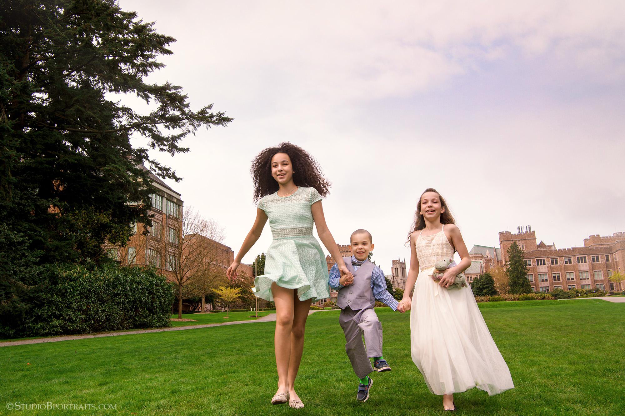 Children skipping in formal outfits at University of Washington_Studio B Portraits.jpg