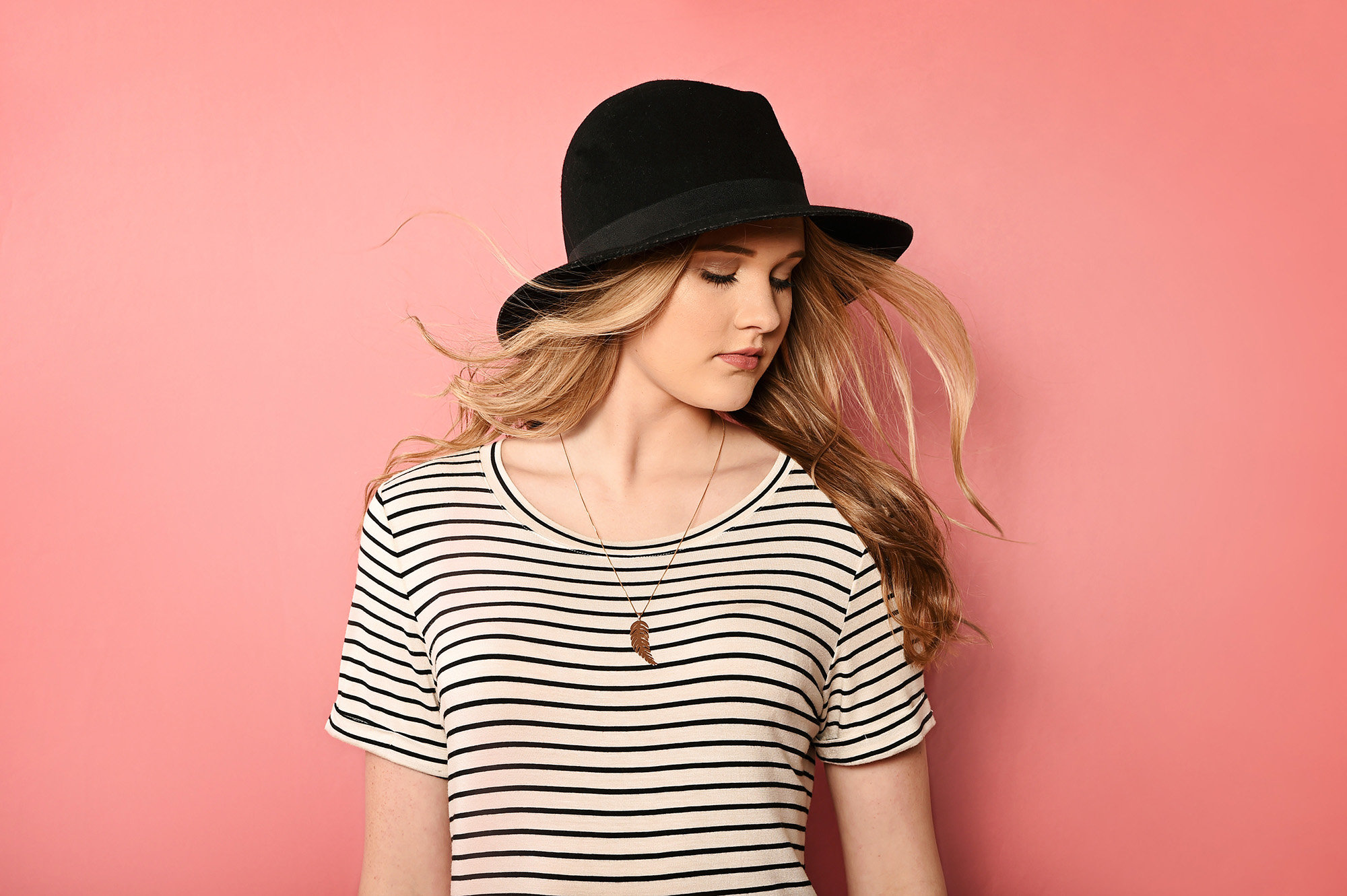 Amazing senior picture of blonde girl in black hat and striped shirt_1719.jpg