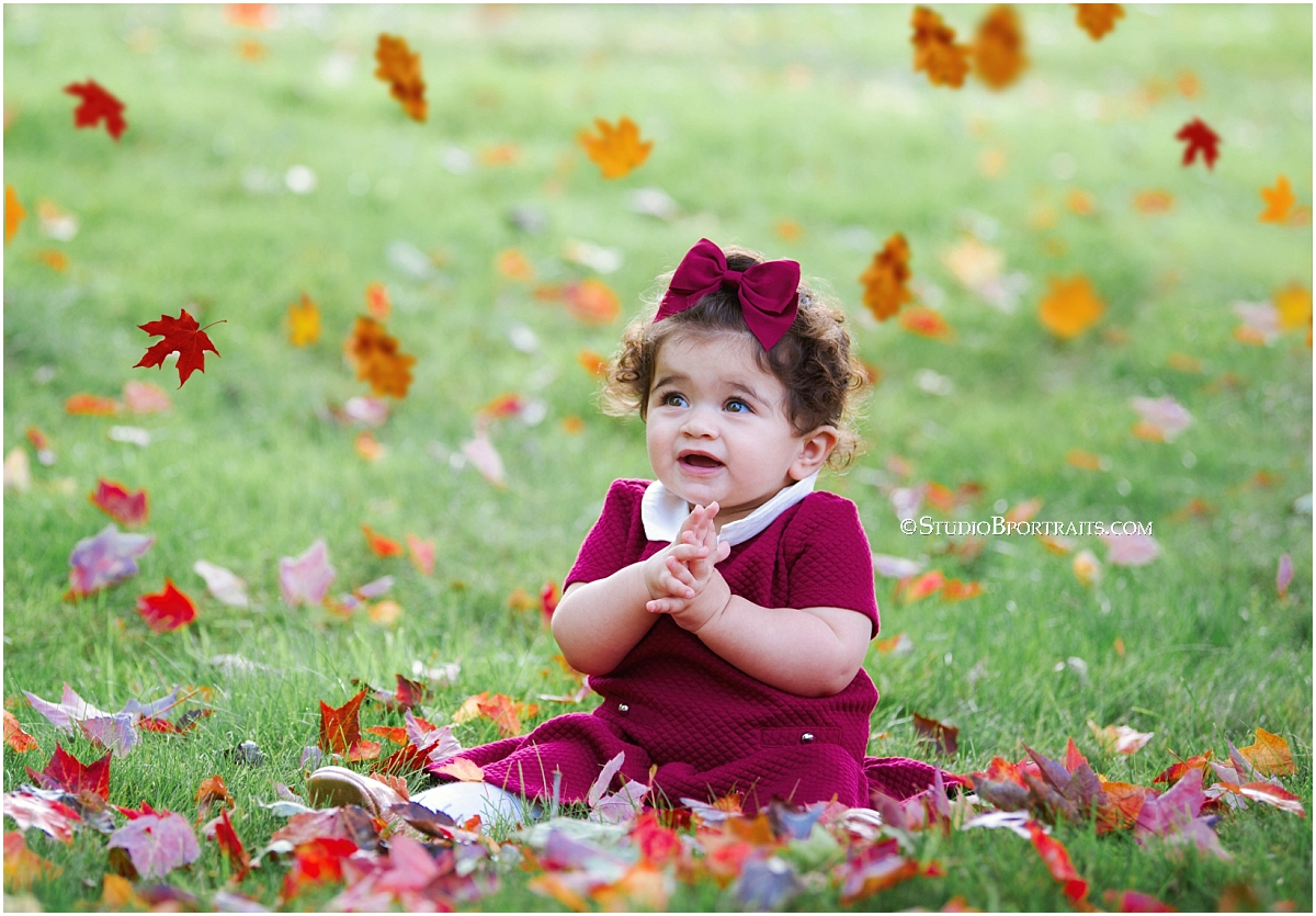 Studio B Portraits_beautiful baby smiling in fall leaves and burgundy dress with bow_0043.jpg
