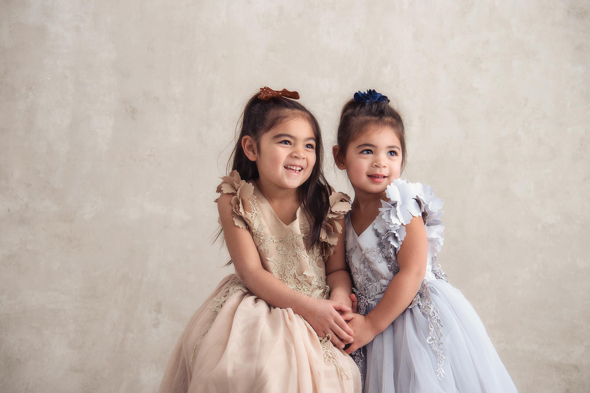 Studio B Portraits_sisters in formal dresses for holidays.jpg