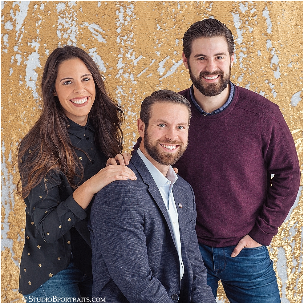 Studio B Portraits best holiday sister and brother picture on gold glitter backdrop.jpg