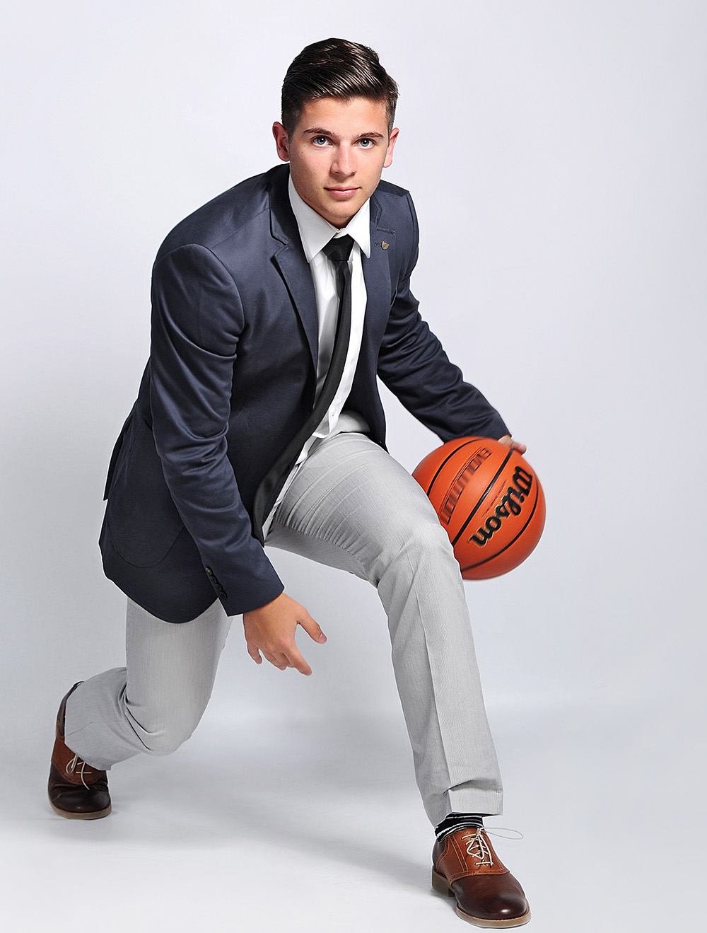 Studio B Portraits_ Senior Boy in suit with basketball.jpg