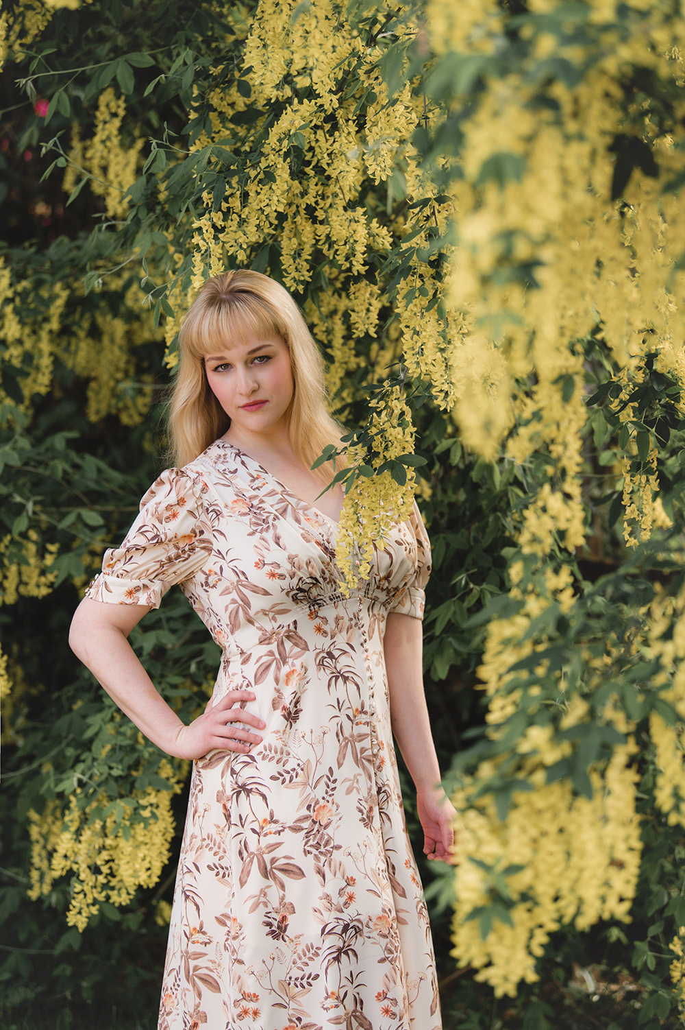 College Senior Pictures_graduation photo of blonde girl in floral dress in yellow flowers_Studio B Portraits_Nelson_4477.jpg
