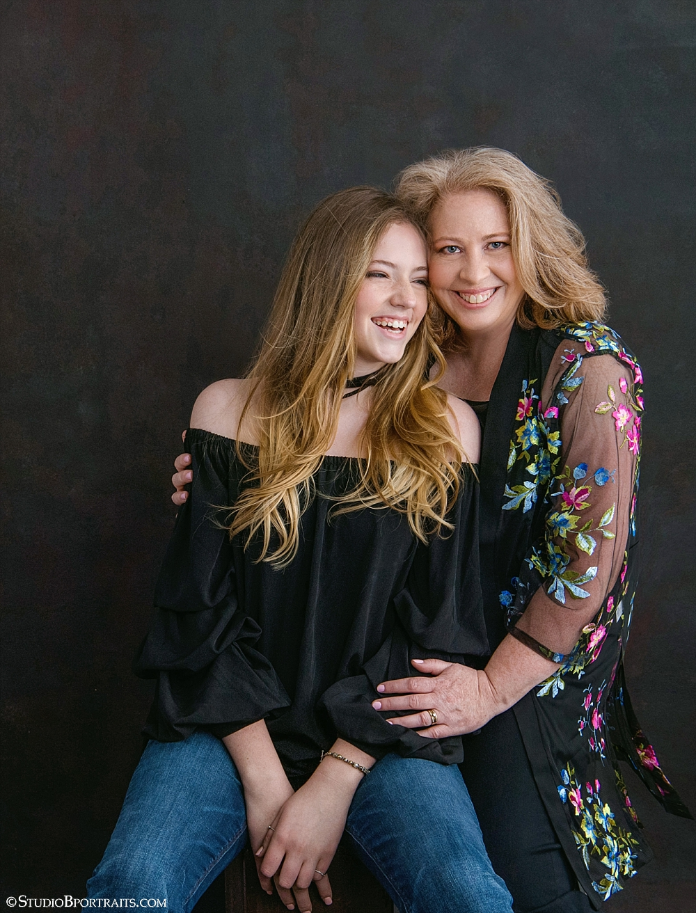 The Mother + Daughter Experience: 14 year-old Sydney and Mom Jennifer sharing a laugh and a snuggle in their first set of outfits