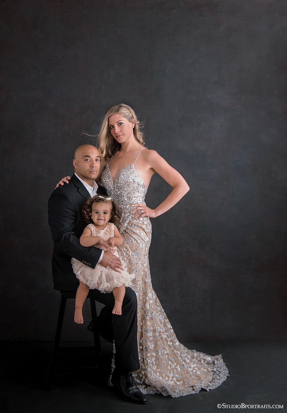 Fierce with a little bit of baby fabulous has never looked so beautiful. Mom's gown courtesy of  Samila Boutique  in Redmond. Make-up, Tiffany Penton and Hair: Wesley Kelly