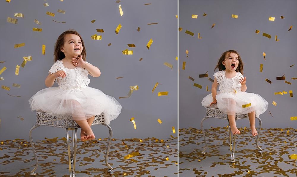 Pretty toddler girl in white dress with gold confetti_Studio B Portraits.jpg