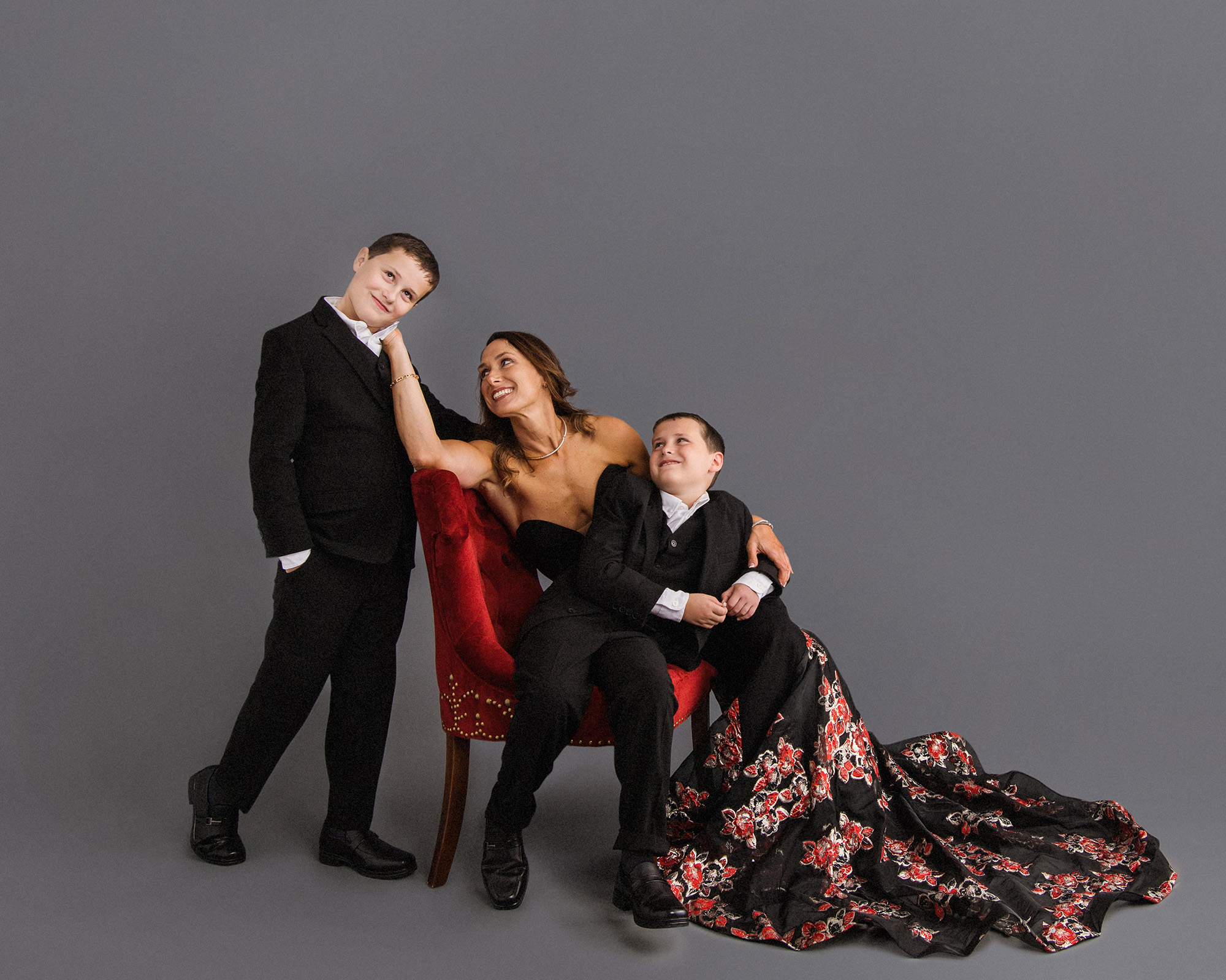 Studio B Portraits_Formal Family pictures of Mom in red gown with twin boys in suit_Warshaw_4143e.jpg
