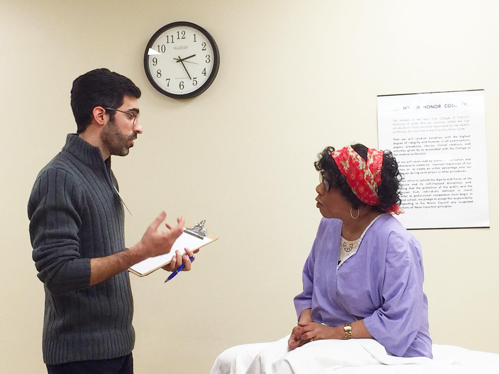 Dr. Mark Swartz, M.D., demonstrates clinical examination techniques using a standardized patient during a Step 2 CS Prep Workshop.
