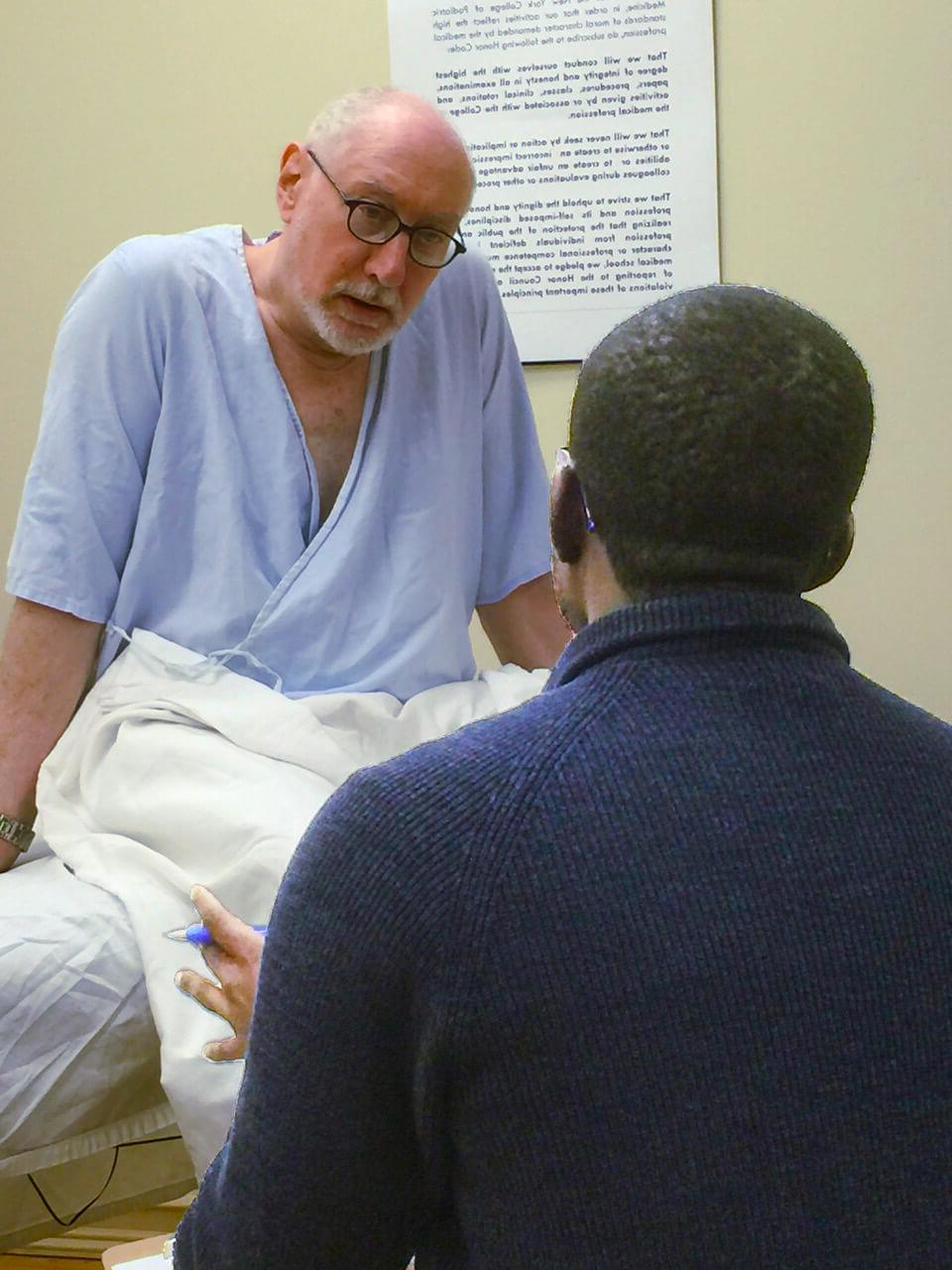 A Standardized Patient portrays a case study during a c3ny Step 2 CS Prep Workshop.