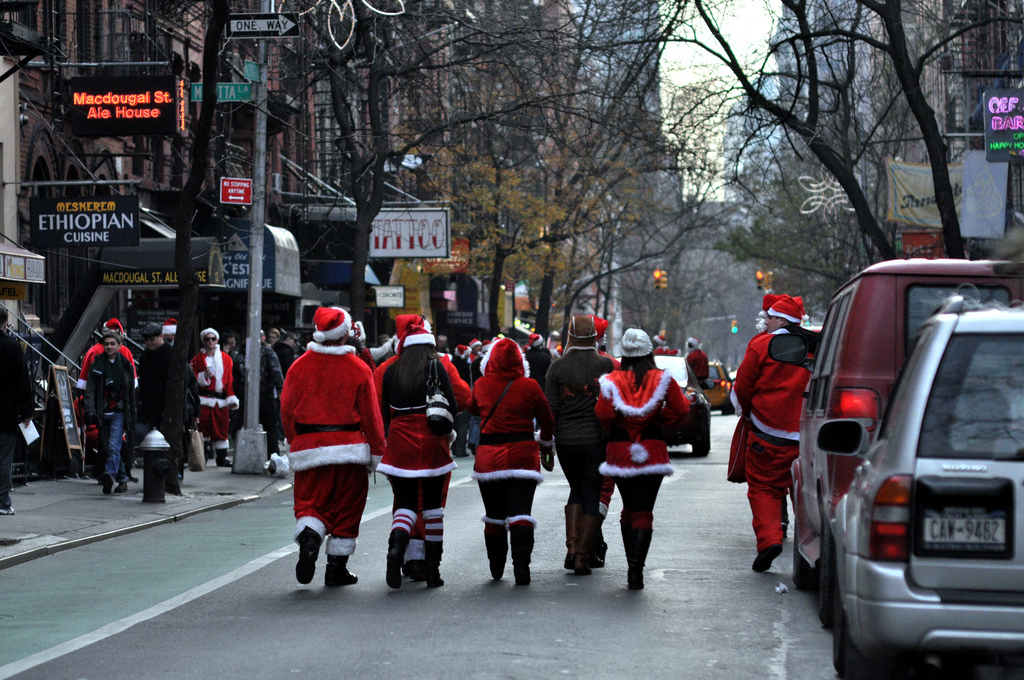 Santacon  participants walk down MacDougal Street on Saturday, December 13, 2010 in New York, NY