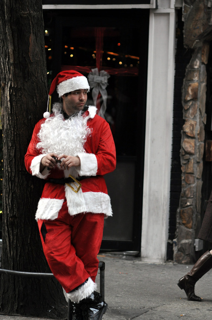 A  Santacon  participant stands on MacDougal Street in the West Village on Saturday, December 13, 2010.