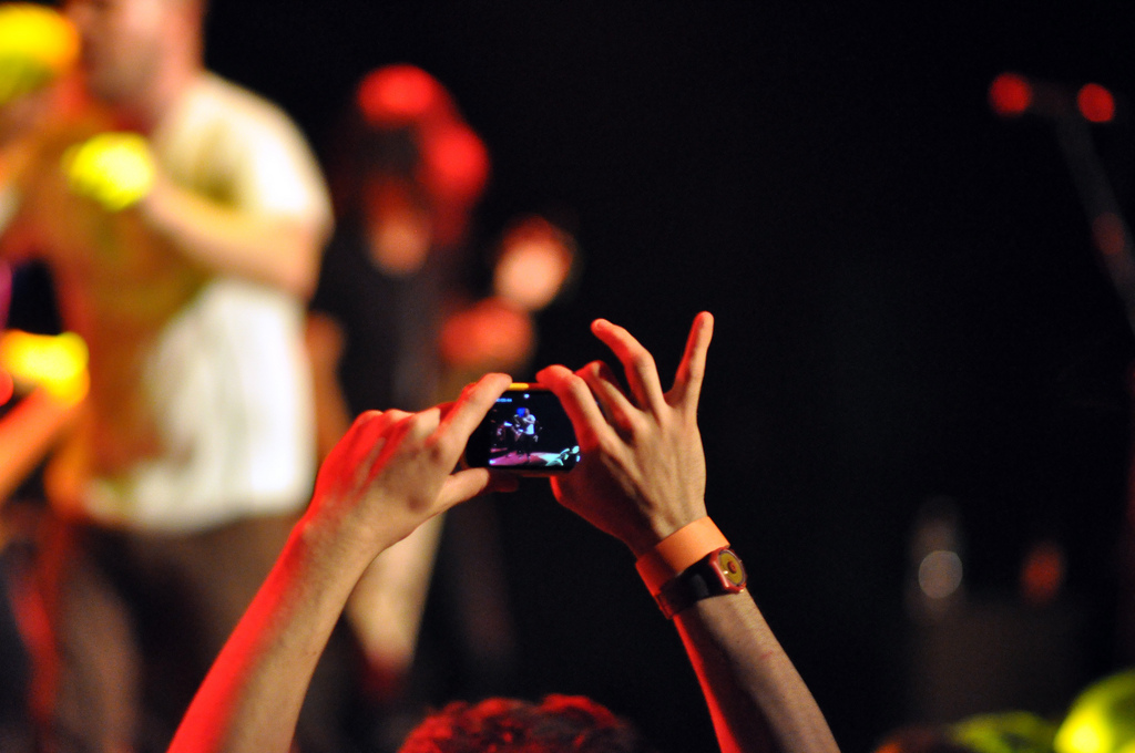 Audience member taking a photo of The Bronx with their phone at Music Hall of Williamsburg