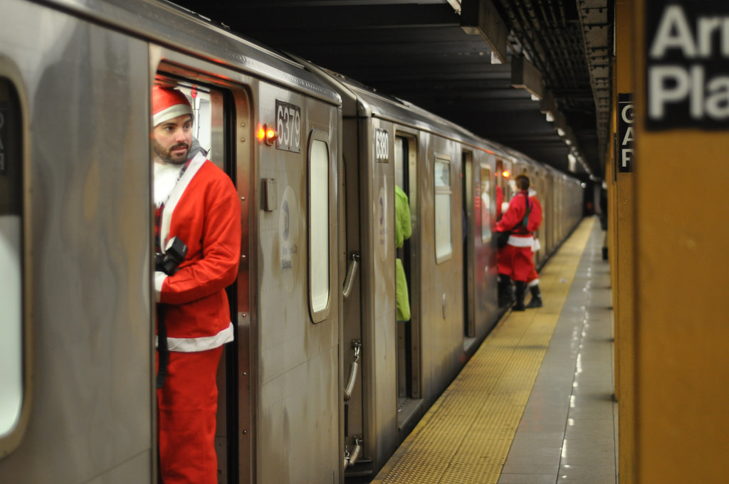 Santacon participants on a Manhattan bound 3 train in Brooklyn, NY on Saturday, December 12, 2009.