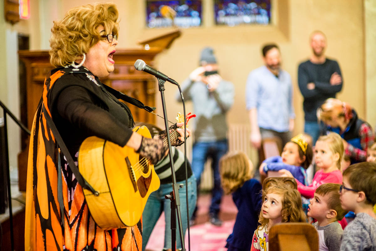 Rev Yolanda sings during Drag Queen Story Hour
