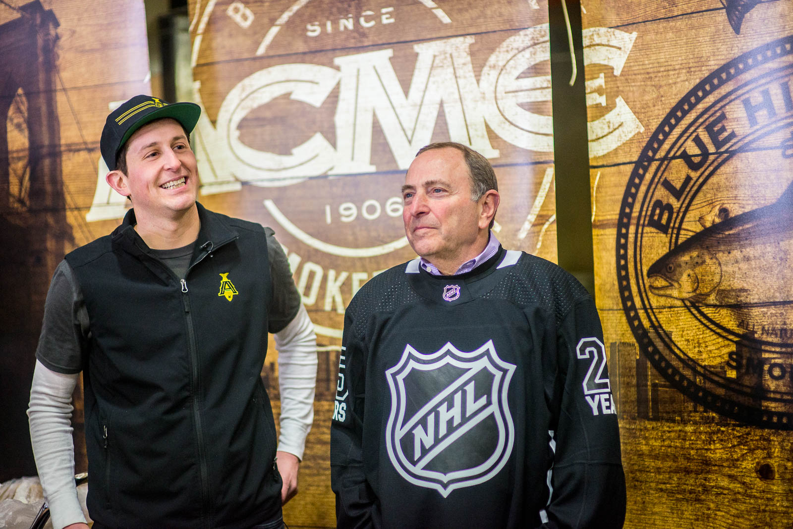 Adam Caslow of Acme Smoked Fish & Gary Bettman of the NHL