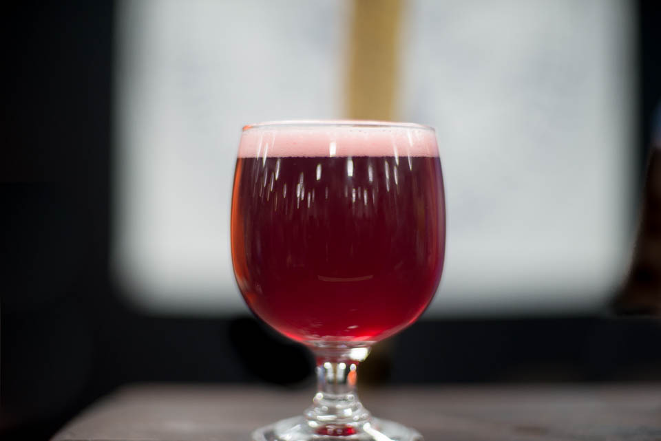 A glass of Raspberry Glow Up by Folksbier at NYC Beer Week Opening Bash on Saturday, February 24, 2018.