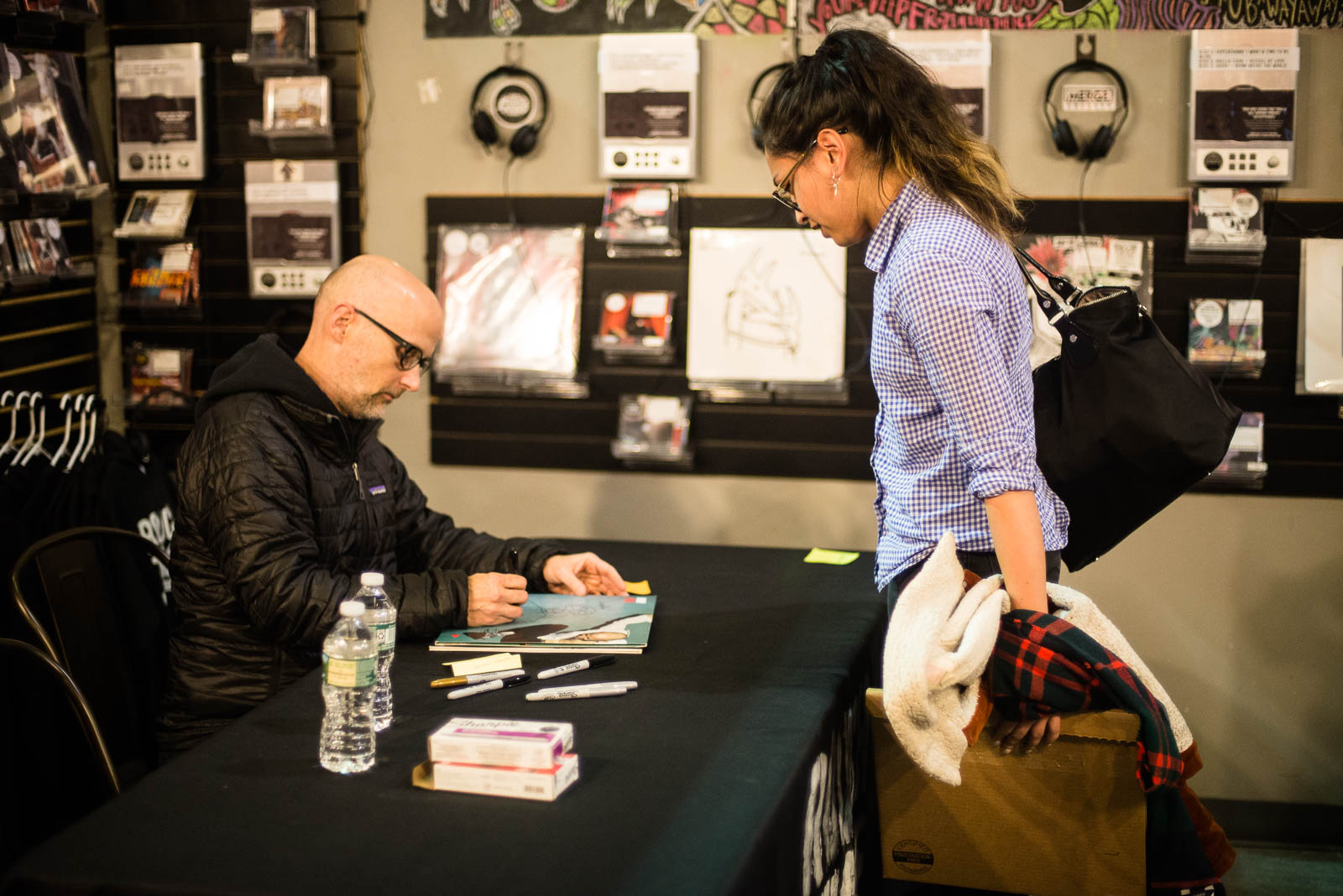 Moby signs a copy of  Play  for a fan at Rough Trade NYC on Tuesday, March 20, 2018.