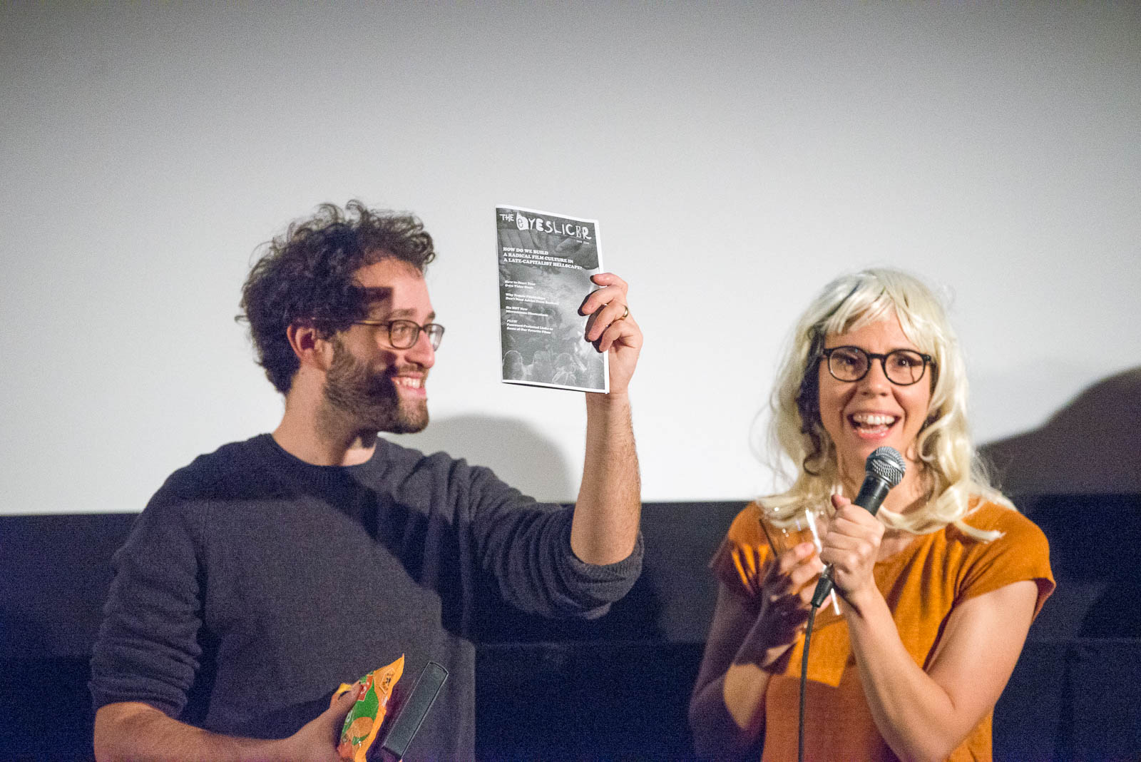 Dan and Vanessa of The Eyeslicer showing one of the costume contest prizes, a copy of a zine