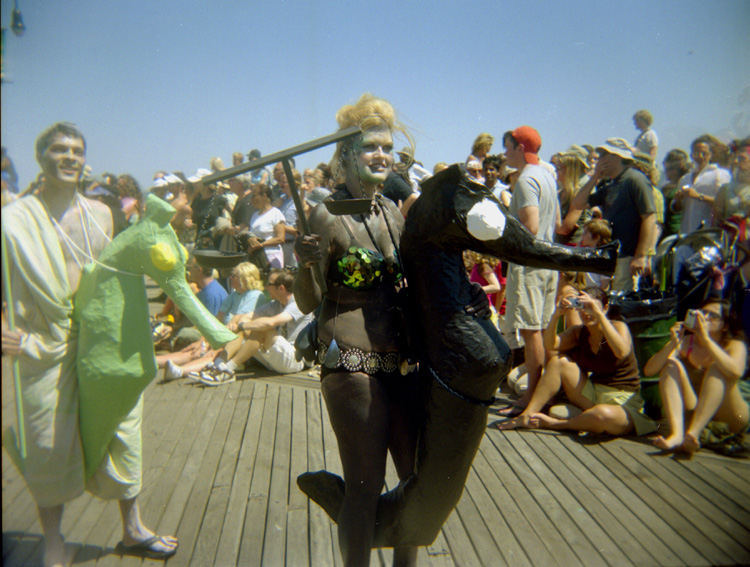 A mermaid parade participant dressed as a mermaid and seahorse taken on film with a Holga camera.