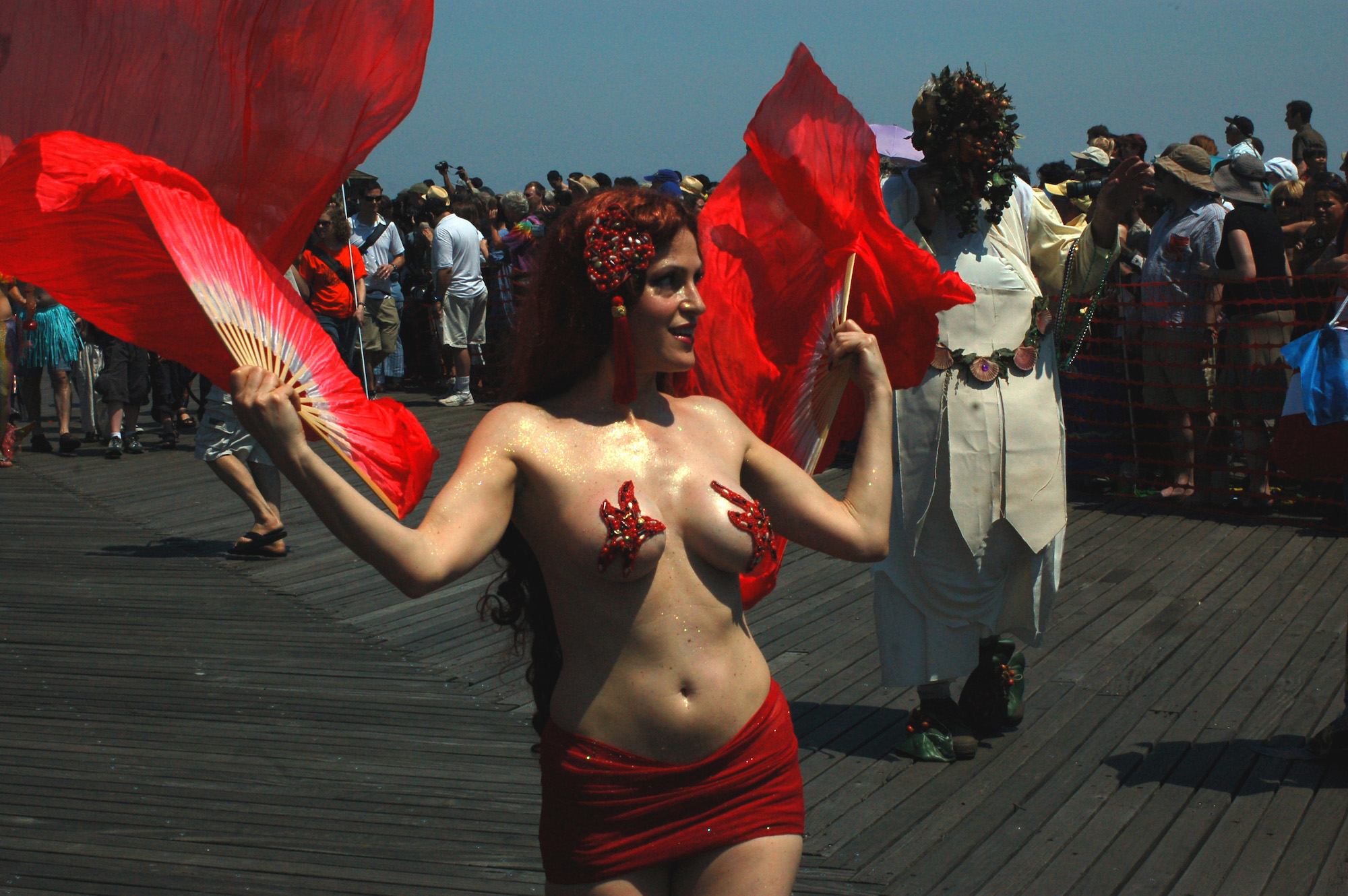 A mermaid uses fans during the Mermaid Parade on Saturday, June 21, 2008.
