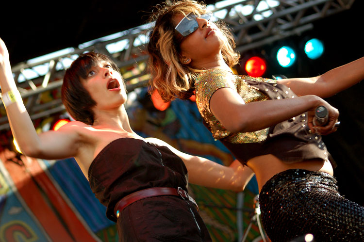 M.I.A. dances with an audience member during the seventh annual Village Voice Siren Festival on Saturday, July 21, 2007.