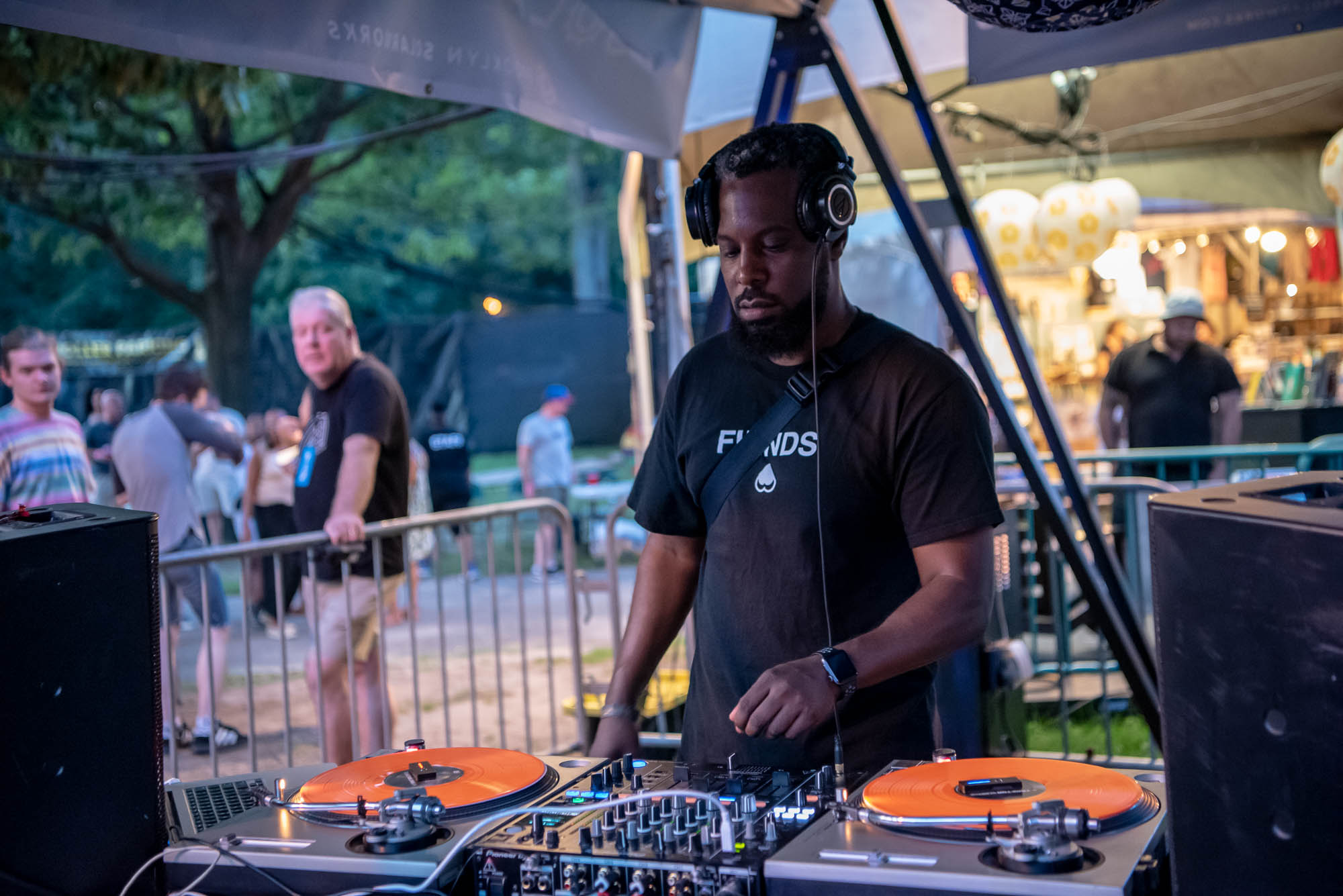 DJ MOMA spins from the crowd at BRIC Celebrate Brooklyn! Festival at Prospect Park in Brooklyn, NY on Friday, July 26, 2019.