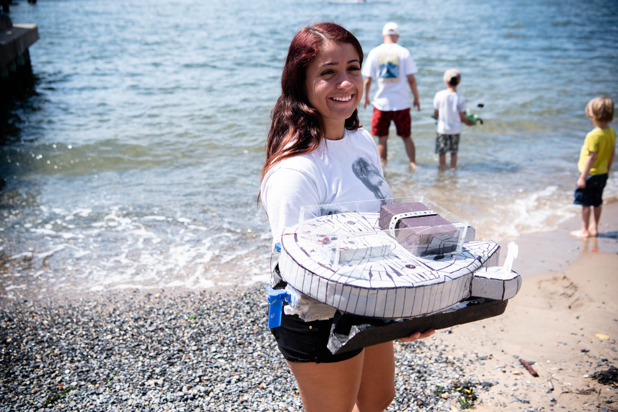 A participant holds their homemade boat, Millennium Falcon, during the Red Hook Regatta on Saturday, August 24, 2019.