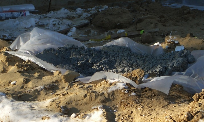 Plastic can be used to contain excess concrete, photograph by Julia Web
