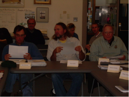 Eric Derleth, U.S. Fish and Wildlife Service; Tim Smith, MA Coastal Zone Management; Jack Whelan, Chequessett Yacht and Country Club (CYCC is involved in restoration land). In the background are members of the public, who are always invited to attend our meetings.