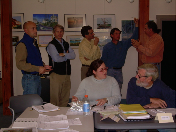 In the foreground: Hillary Greenberg, Wellfleet Health and Conservation Agent; Joel Fox, Aquaculturist. In the background are three representatives from the consulting firm of ENSR, who are working with the HRTC. From left to right, Mike Ball, ecologist; Dennis Lowrey, wetlands ecologist; Firooz Pannah, bridge engineer. Eric Derleth and Stephen Spear are HRTC members.