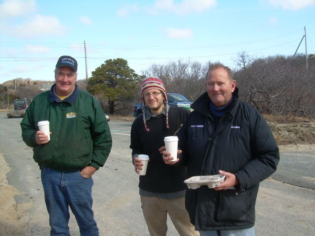 Town DPW Director Paul Morris and Safe Harbor workers take a well deserved break.