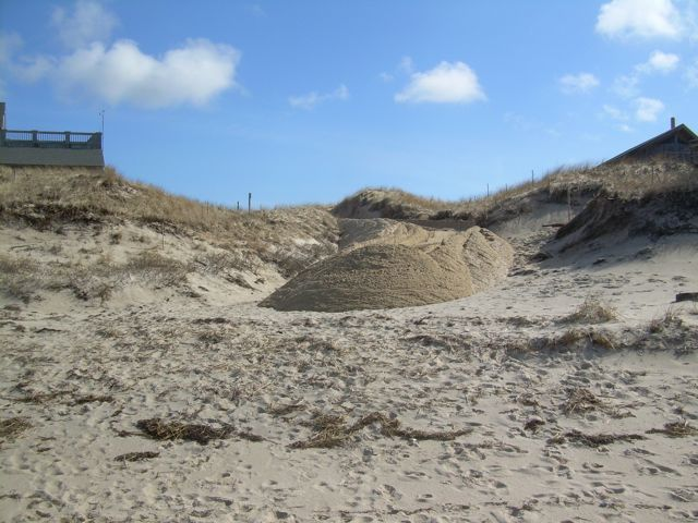 Empty bowl on beach shown here with sand bulldozed in.