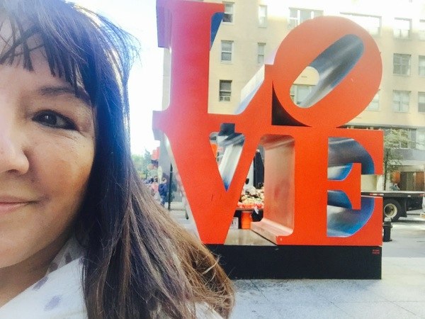 """Selfie near my NYC hotel — The sculpture by Robert Indiana that pretty much says it all. Also had to give in and buy an """"I love Pope Francis"""" t-shirt, too... and I'm not even Catholic!!! Photo ©2015 Sandra CisnerosPhoto ©2014 Sandra Cisneros"""
