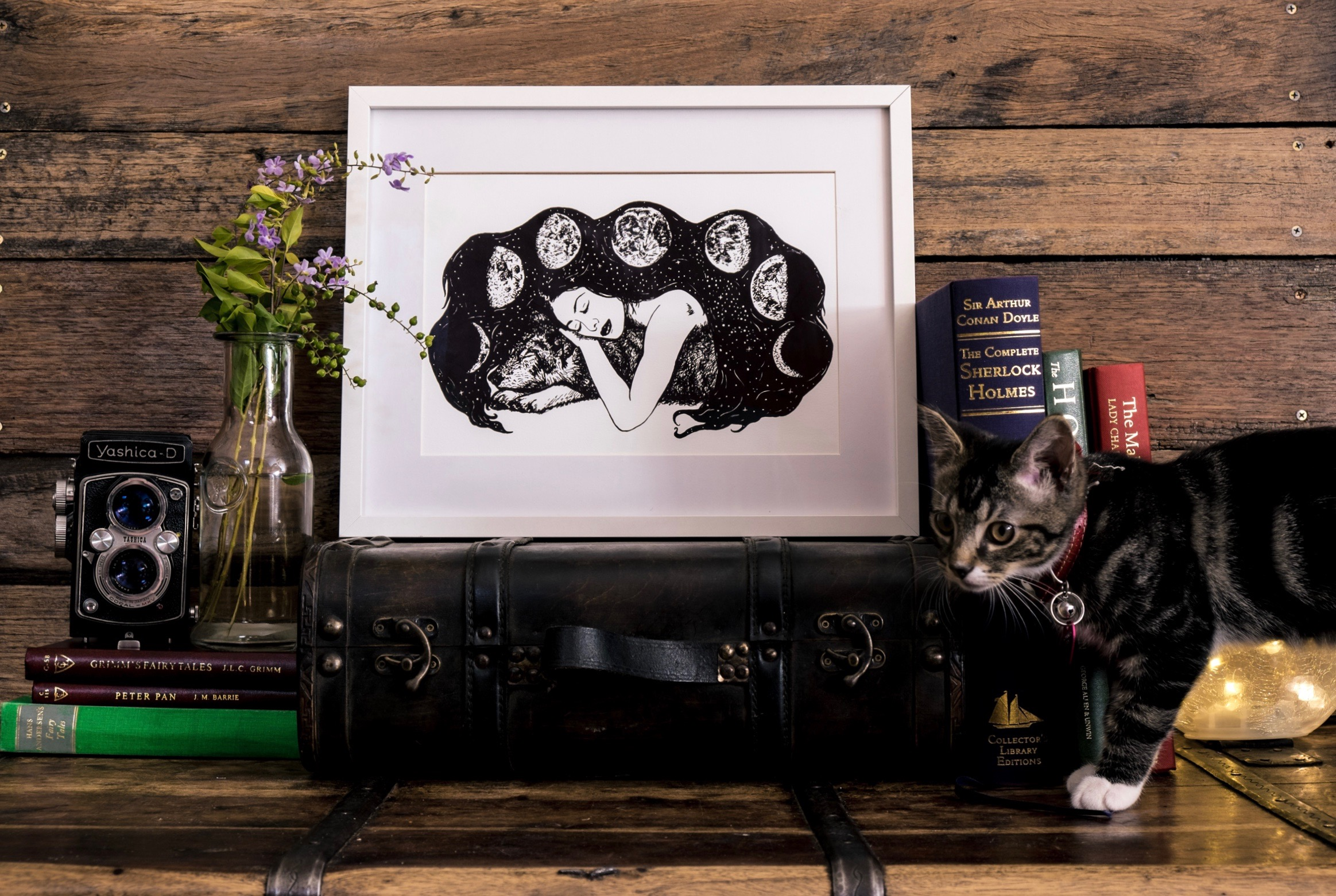 Behind the scenes of our photo shoot with its frequent kitten interruptions. Pictured is  the Wolf and the Moon  A4 print.