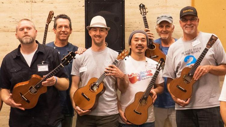 Luthiers for a Cause ukulele builders, from left: Jay Maclay, Jay Lichty, Beau Hannam, Joji Yoshida and Steve Grimes with Kevin Beddoe, right, owner of Fallbrook's KinnardUkes, at a gathering in Hawaii in November 2017. (Luthiers for a Cause)